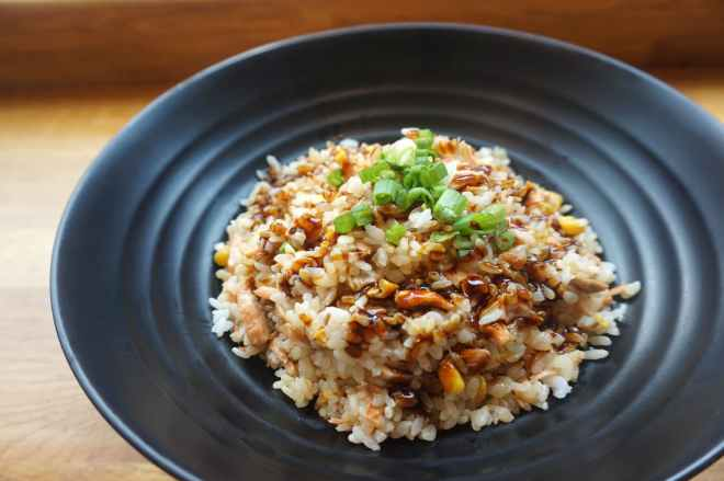 cooked rice on black ceramic plate