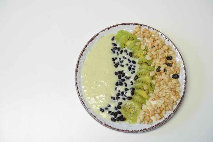 slice kiwifruit and nuts on plate