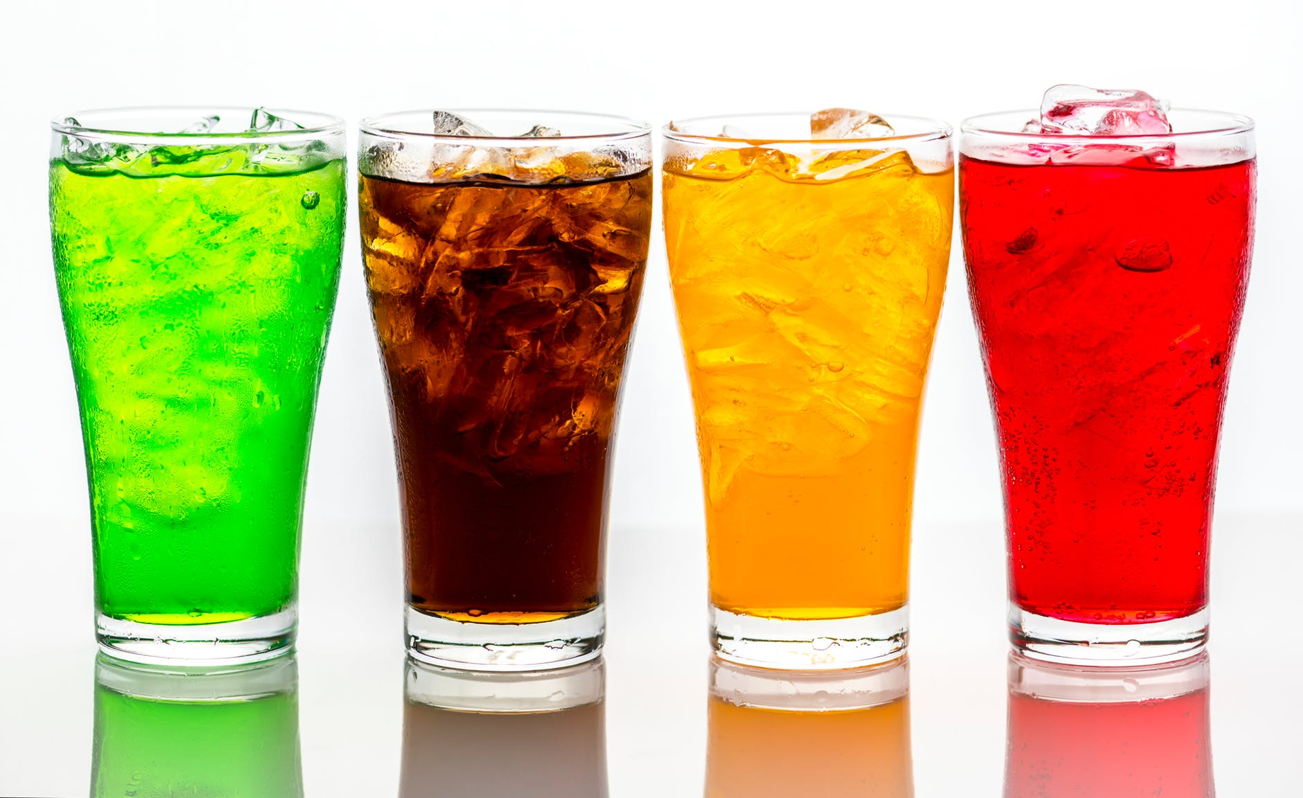 photo of four assorted color beverages
