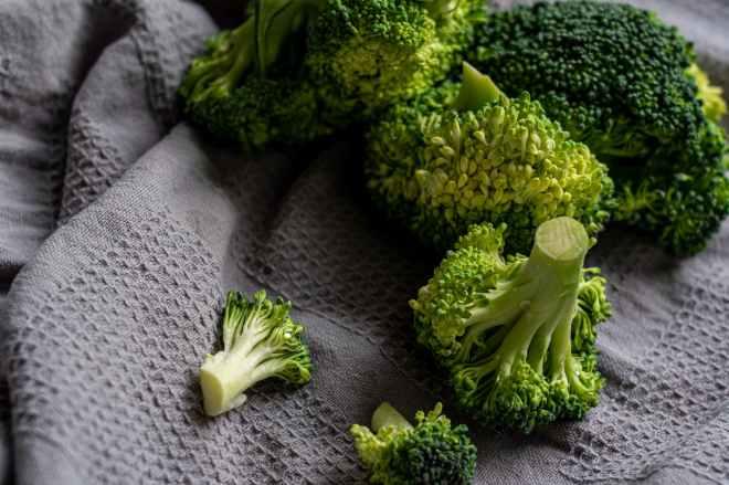 green broccoli on white textile